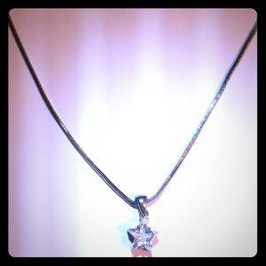 Silver tone star cz pendant.